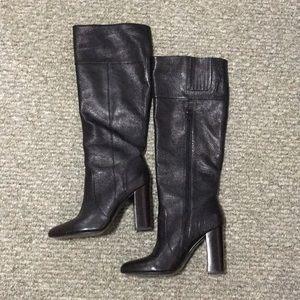 Knee length heeled boot